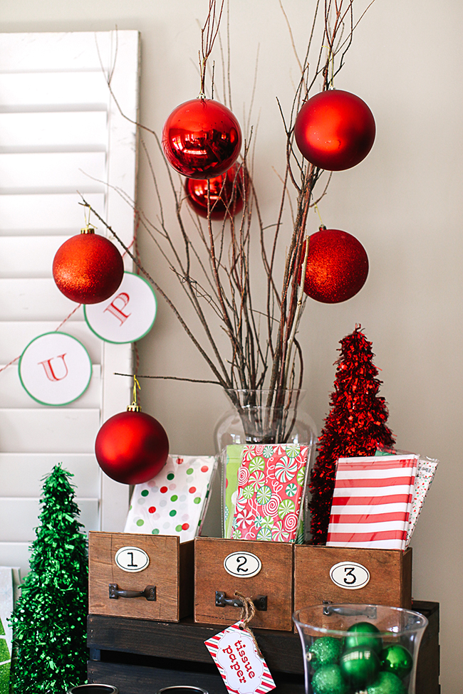 Decorate with large ornaments to give your gift wrapping party a special touch. Don't forget the cute tissue papers!