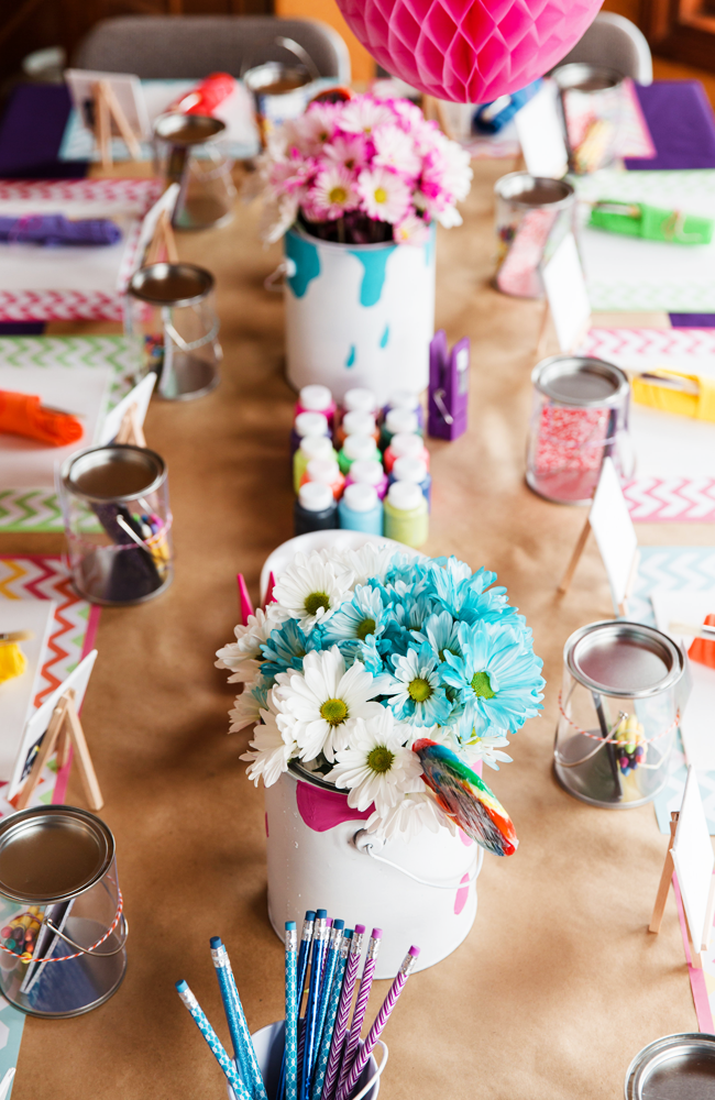 We love the use of bright fun flowers to brighten up this Art Party!