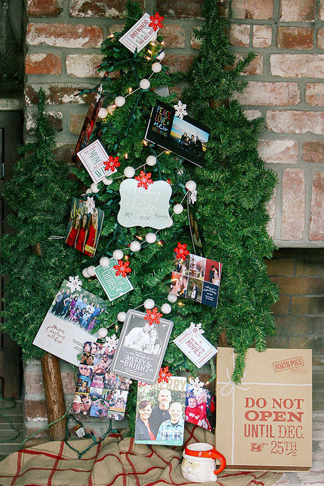 Display your Christmas cards on a tree. This is an easy way to display your cards and decorate your Christmas tree!