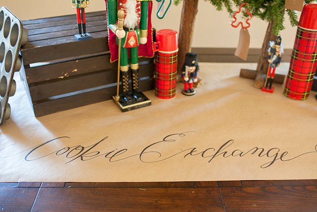 Make your own runner with kraft paper and sharpie! Easy Cookie Exchange party decor idea.