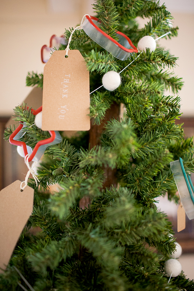 Give your guests a cute cookie cutter at your Cookie Exchange Party! Hang them on a small tree as ornaments, and let your guests choose one at the end of the party.