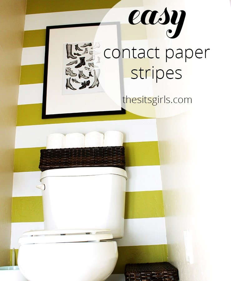 One of the best small bathroom design ideas. Use contact paper to create stripes on your wall. This is a simple and easy diy bathroom redo, and a great design idea for renters.