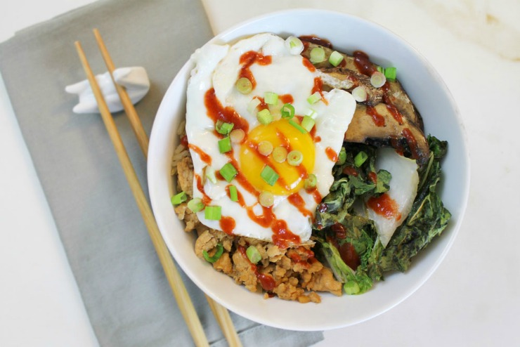Rice bowl with chicken, and egg, roasted bok choy, mushrooms, and sriracha