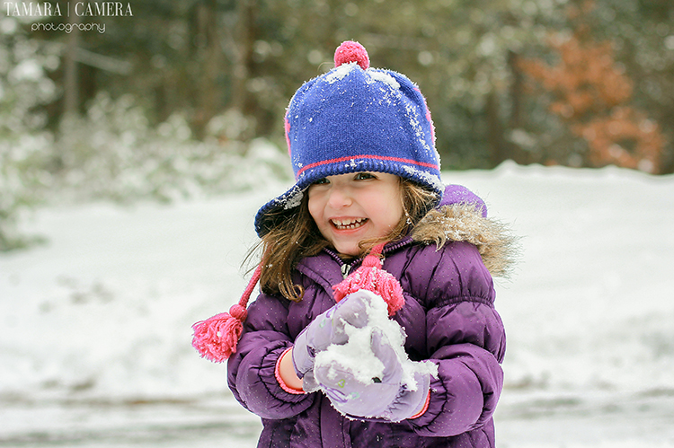 Little girl with snowball.
