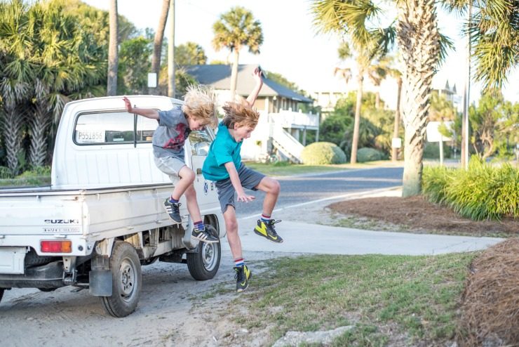 Boys jumping out of truck.