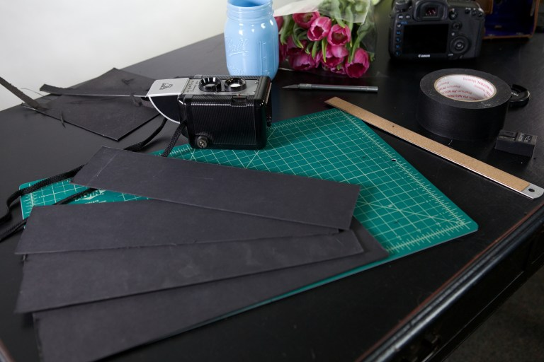Cut strips in your cardstock for your camera attachment.
