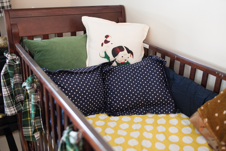 Mix and match patterns in your crib. Love the cute Pokey Puppy pillow for a baby boy's nursery.