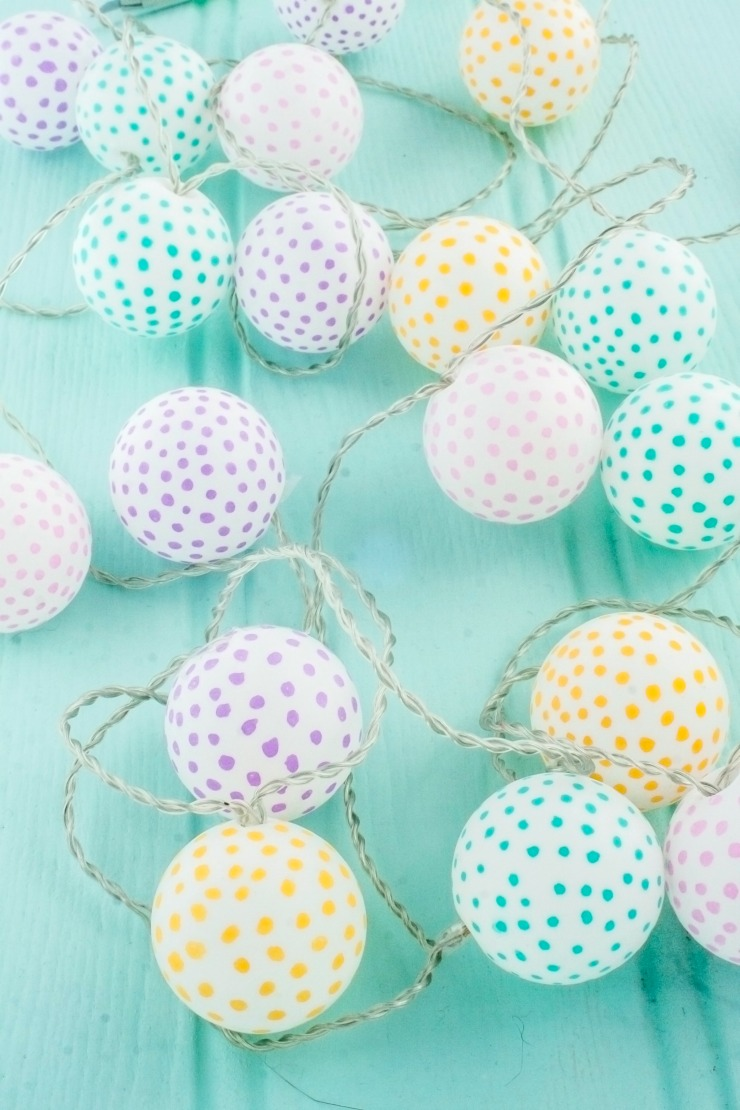 An easy DIY project to create your own party lights out of ping pong balls. This is a super cute party decoration you can customize to match any theme.