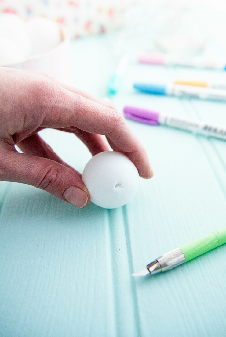 Cut a hole into your ping pong ball with a sharp knife.