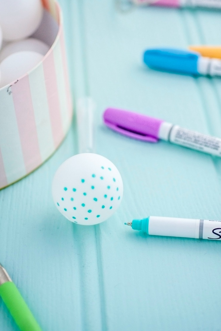 Draw polka-dots on your ping pong balls.