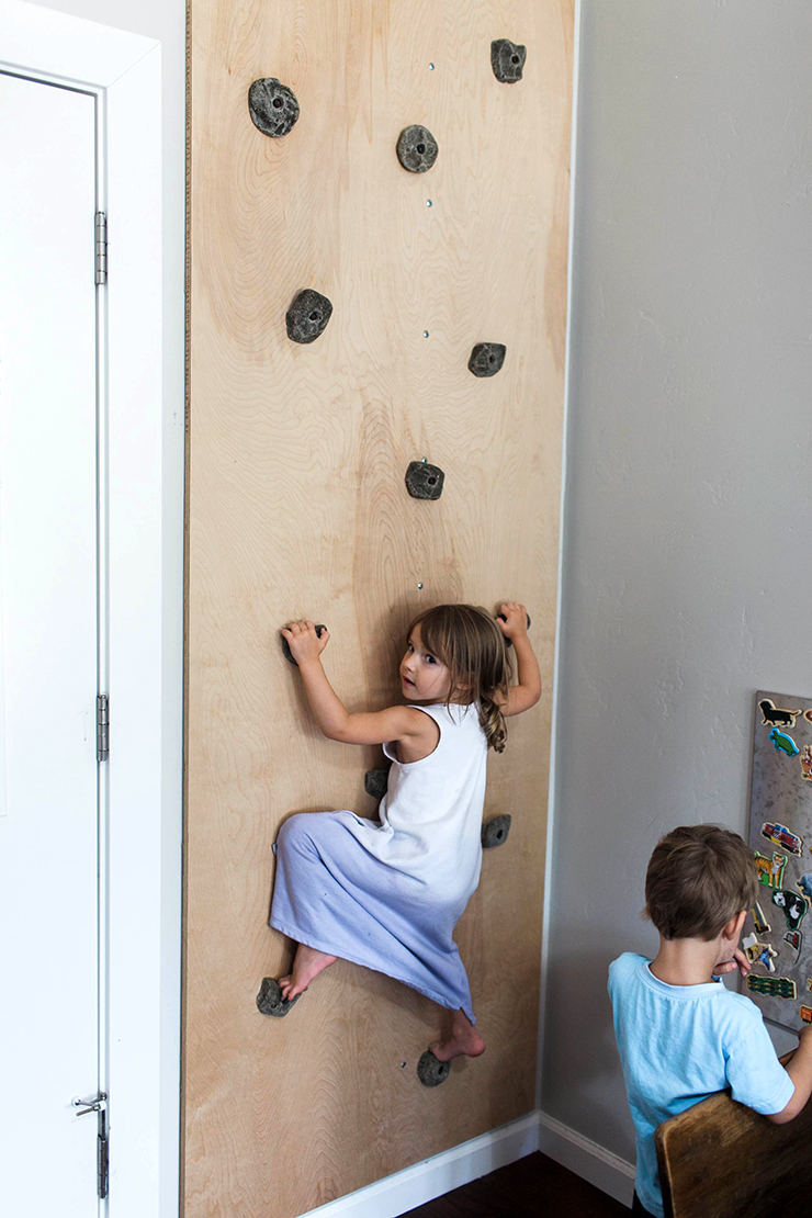 A rock climbing wall in the playroom?! LOVE this idea!