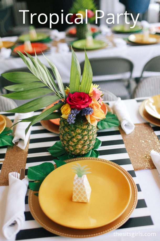 How to throw the perfect tropical party with delicious food and cute party decor. The flamingos and pineapple flower arrangements make it extra fun.