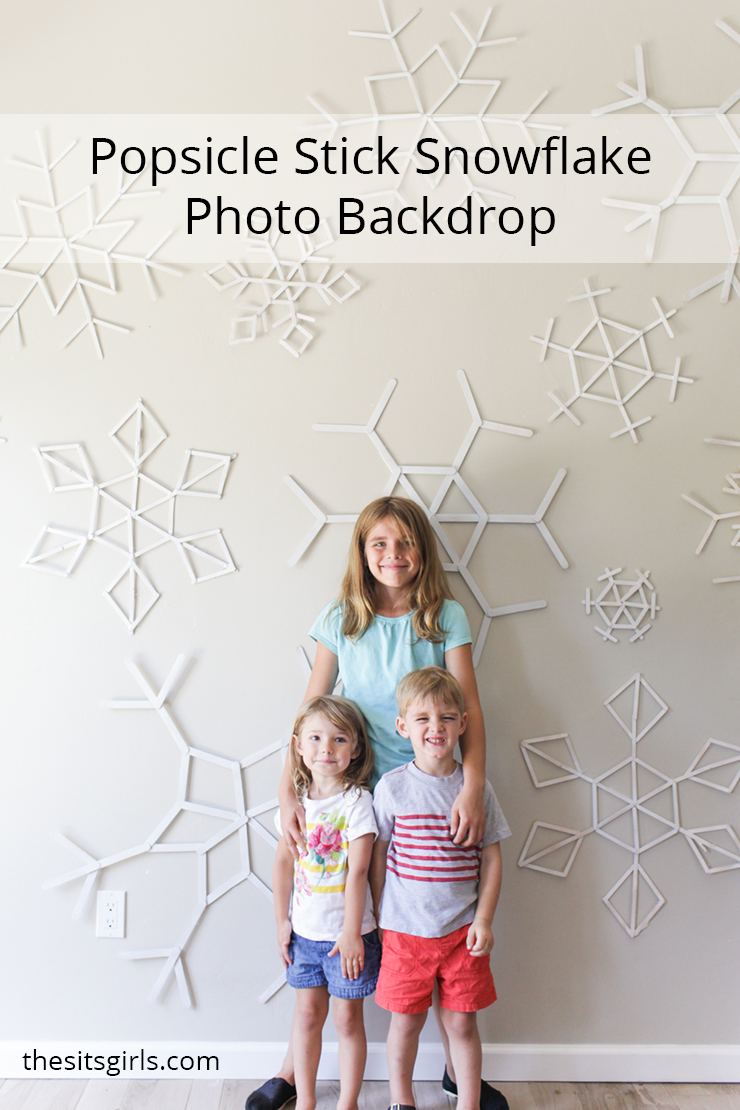 DIY popsicle stick snowflakes make a beautiful photo backdrop wall. This would be beautiful for a wedding or any party. They are super easy to make!