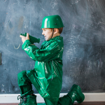 This toy army man costume is one of the easiest DIY Halloween costumes we have made. You only need a few simple items and a can of green spray paint!