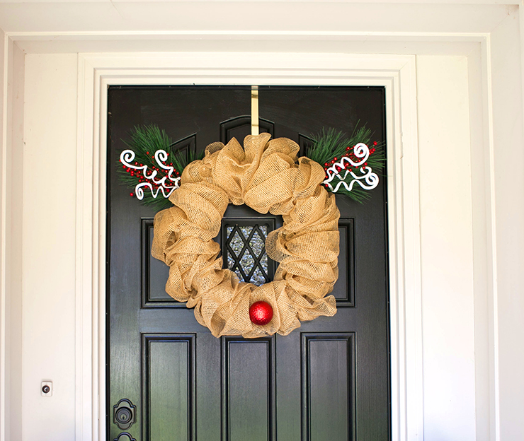 Decorate your front door for Christmas with this cute Rudolph Wreath. This is an easy project using a pool noodle. Make your own Christmas wreath for $10.