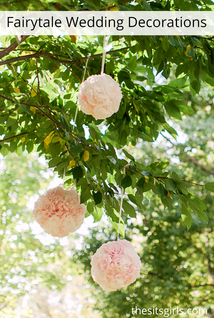 Fairytale wedding decor - love how pretty these flower balls look hanging from the trees.
