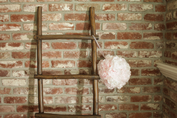 flower ball hanging from ladder