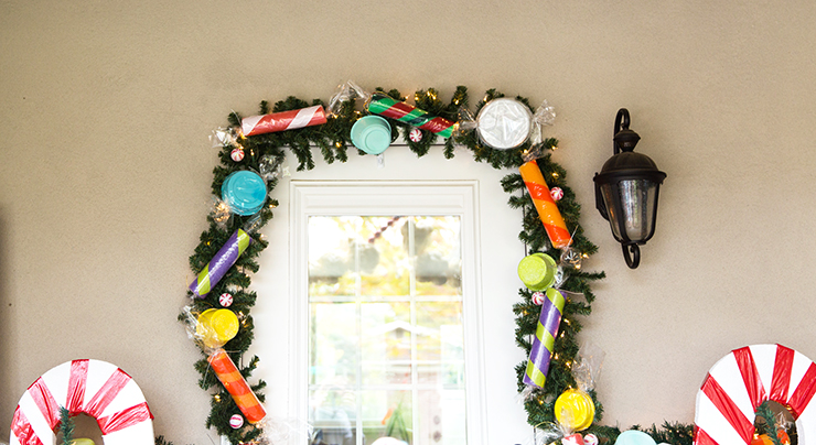 Use pool noodles and old food containers to make this cute candy garland!