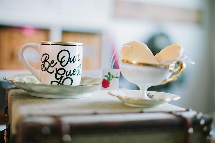 Old teacups and saucers were the perfect accent for this cute Beauty & the Beast shoot!
