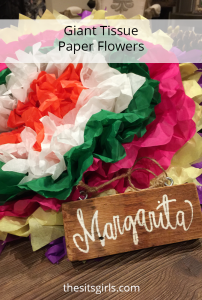 You only need tissue paper, scissors, and string to make these adorable giant tissue paper flower puffs!