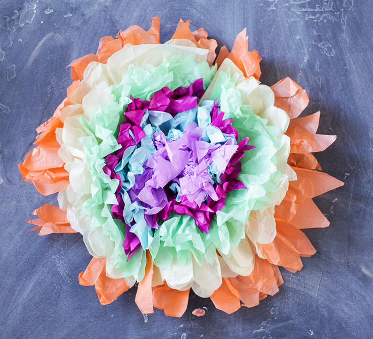 Use tissue paper to create these flowers!