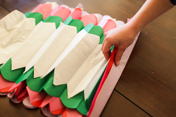 Fold these tissue papers accordian style to make cute flowers!