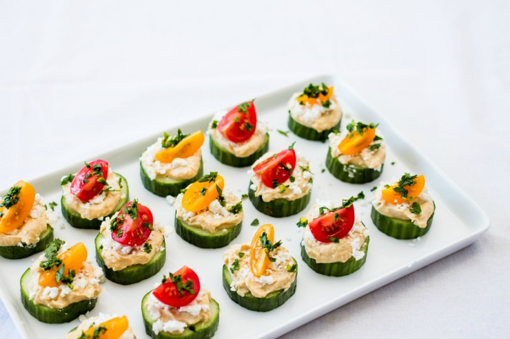 Cucumber and Hummus Bites with cherry tomatoes