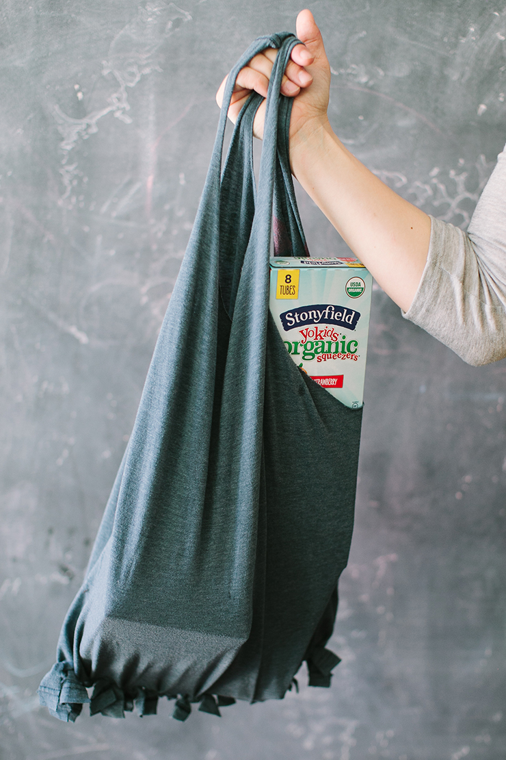 Make a reusable bag out of an old t-shirt.