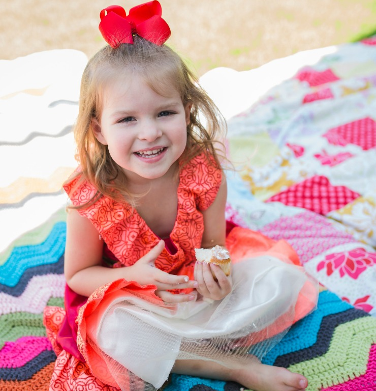 Colorful quilts are perfect for a royal picnic station at your princess party.