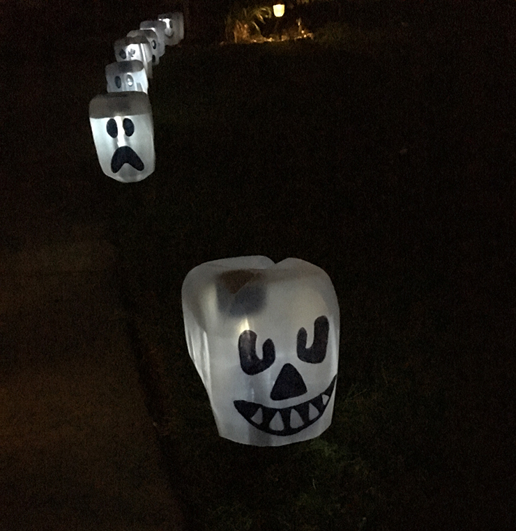 Use dollar tree stakes to make these glowing ghosts!