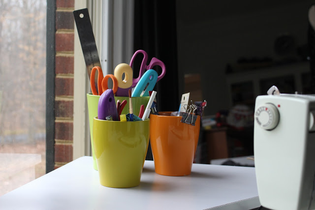 Clearance planters make great storage containers for sewing tools.