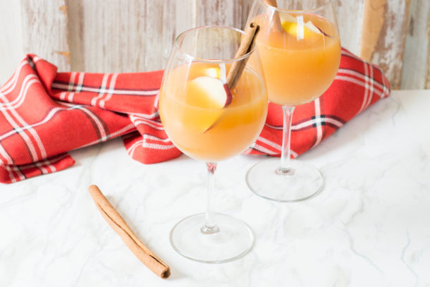 Apple Cider Sangria uses just a handful of ingredients, and is perfectly crisp and refreshing for fall. Make this recipe for all of your fall get togethers!
