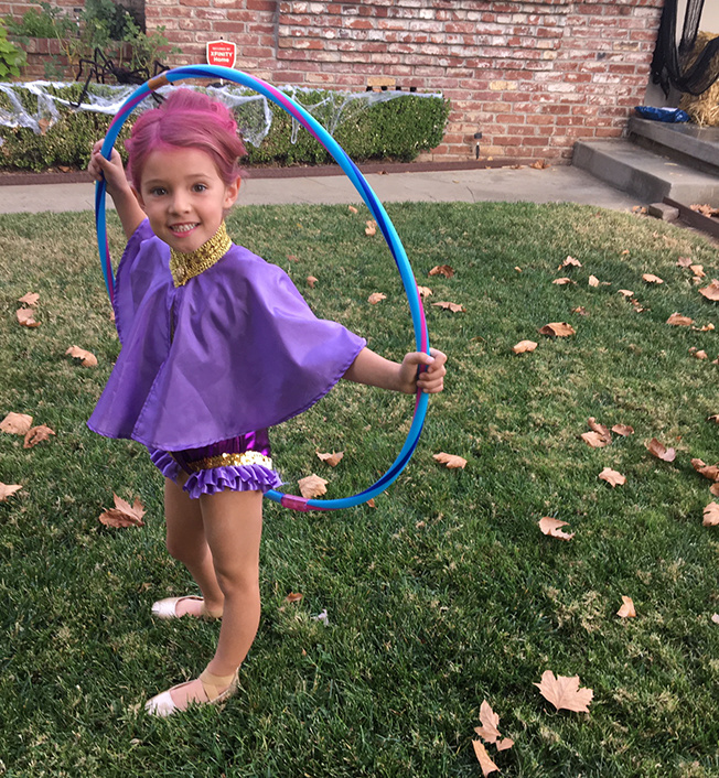 girl wearing halloween costume inspired by the greatest showman