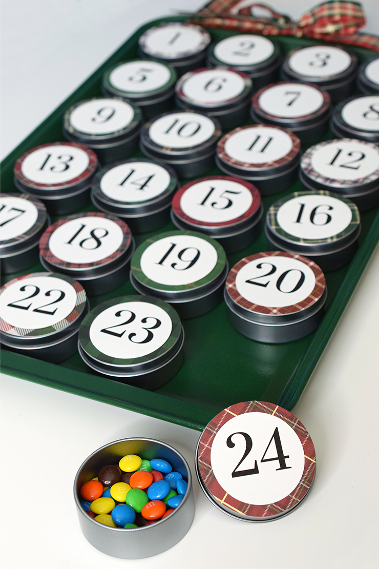 Fill your magnetic advent calendar tins with candy and attach to the cookie tin