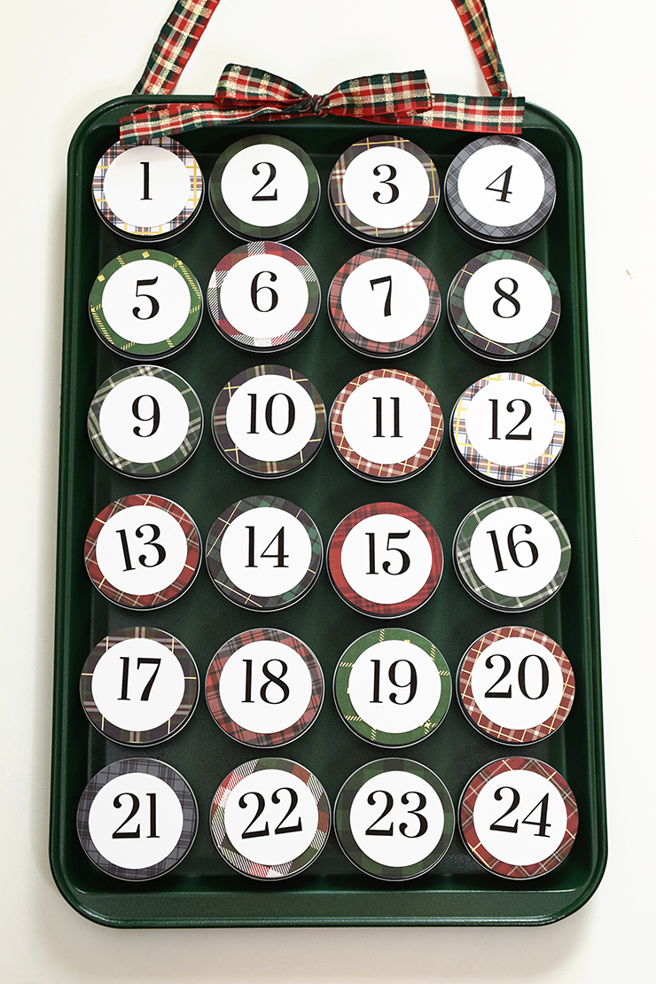 magnetic advent calendar with metal tins and ribbon