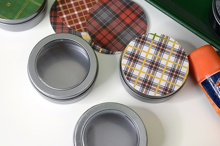 Add Christmas patterned paper to metal tins with a glue stick