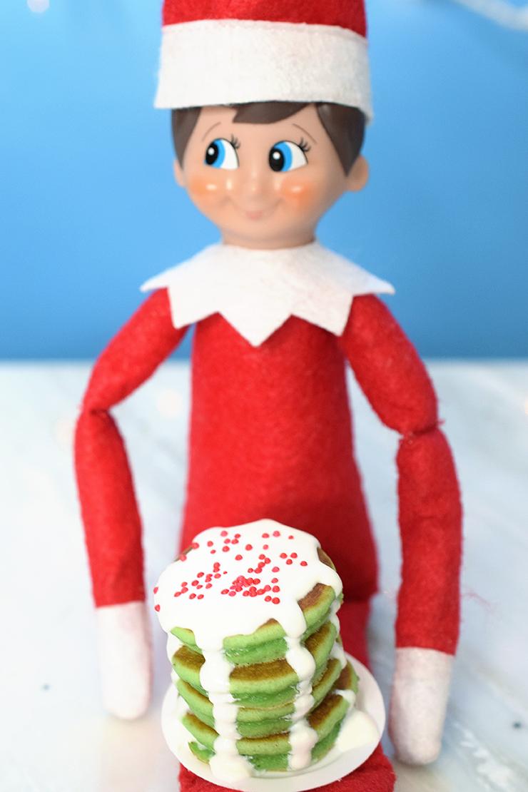 Elf holding mini pancakes wtih plate