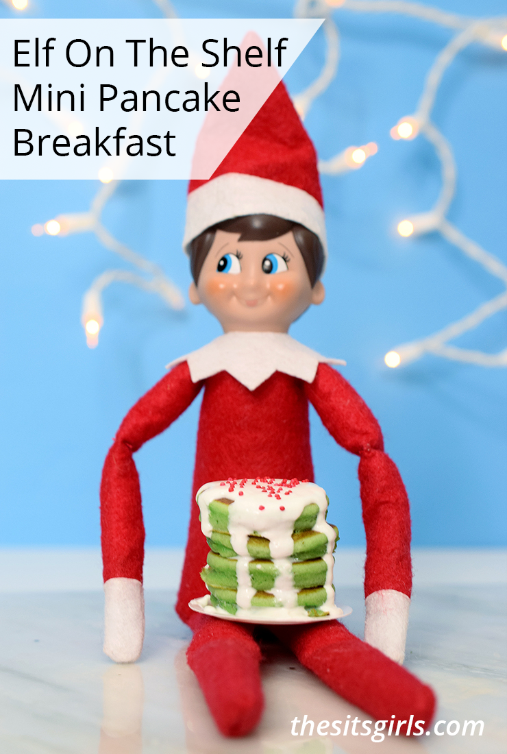 Elf on the Shelf mini pancake breakfast | Elf holding stack of green pancakes topped with icing and sprinkles