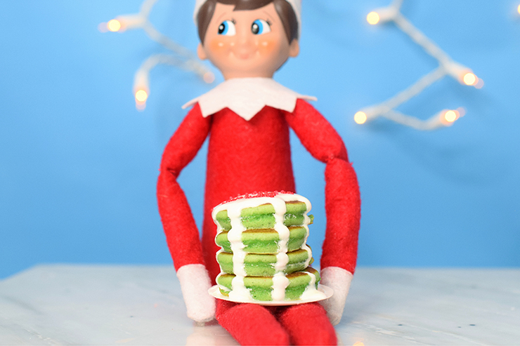 stack of green pancakes with icing