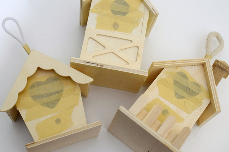 birdhouses with masking tape covering holes