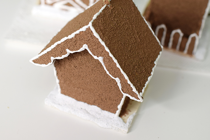 white paint mixed with sand makes snow for your birdhouse gingerbread house