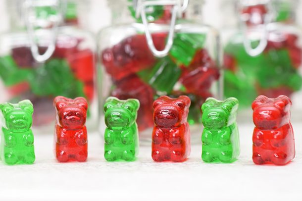 line of red and green gummy bears