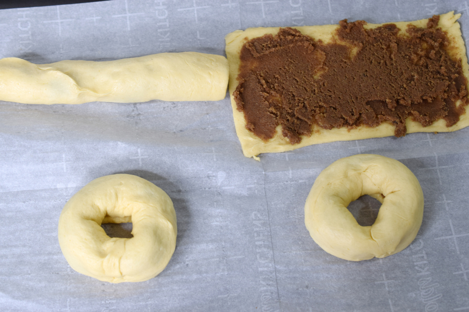 Add filling to crescent rolls and roll them up like doughnuts.