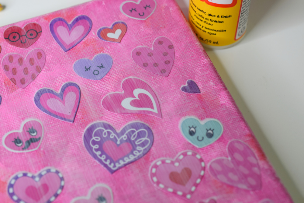 Mod Podge painted over stickers on canvas.