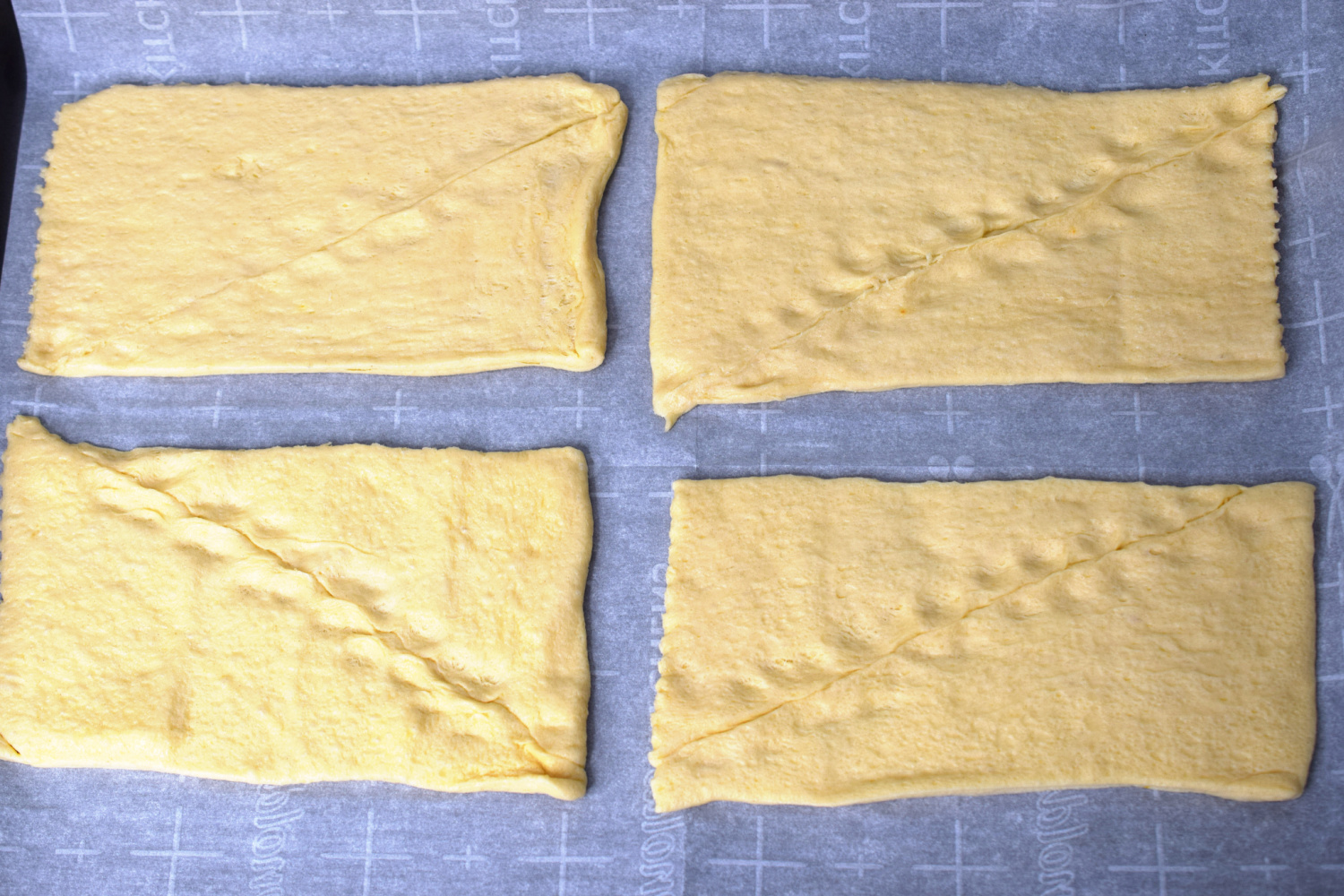 Crescent rolls separated into rectangles.