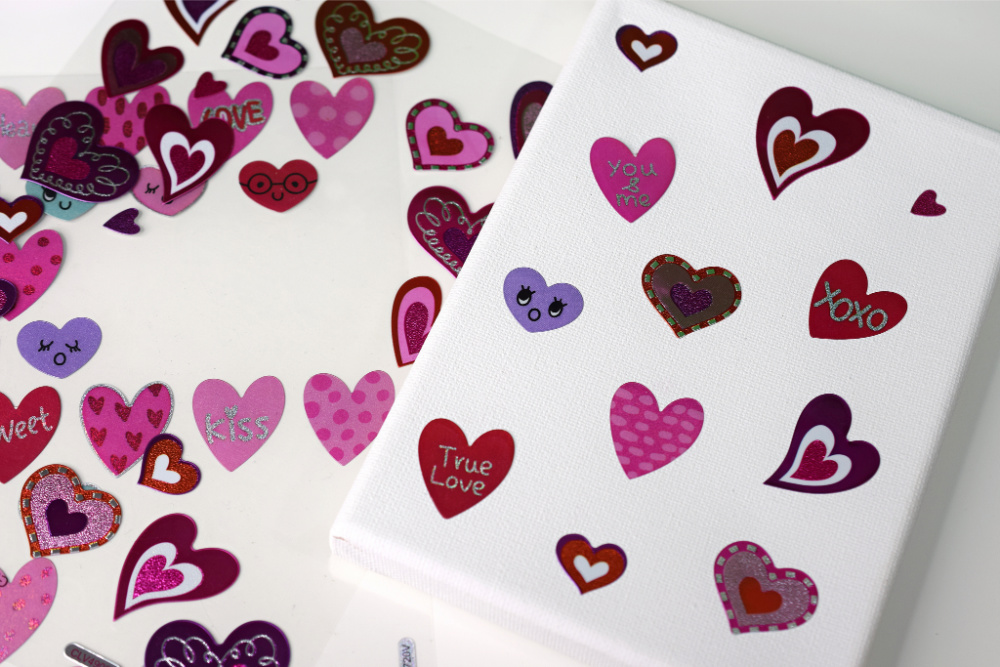 Heart-shaped stickers on canvas.