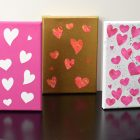 Three canvases with Valentine's Day artwork, each canvas has hearts.