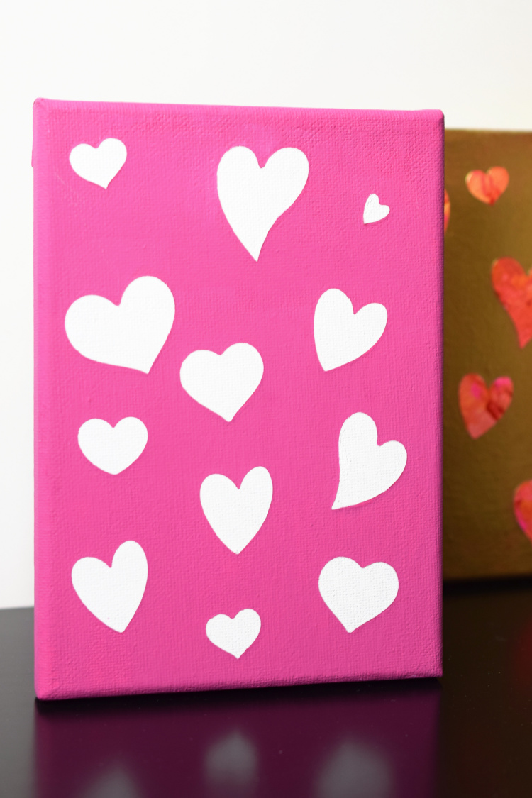 Pink canvas with white hearts.