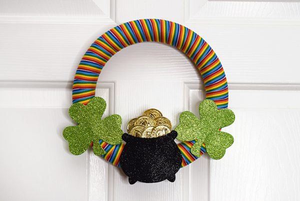 St. Patrick's Day Rainbow Wreath hanging on door.