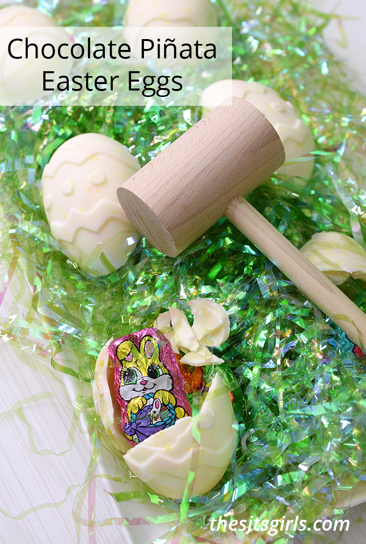 Chocolate Piñata Easter Eggs with wooden mallet on green Easter grass.